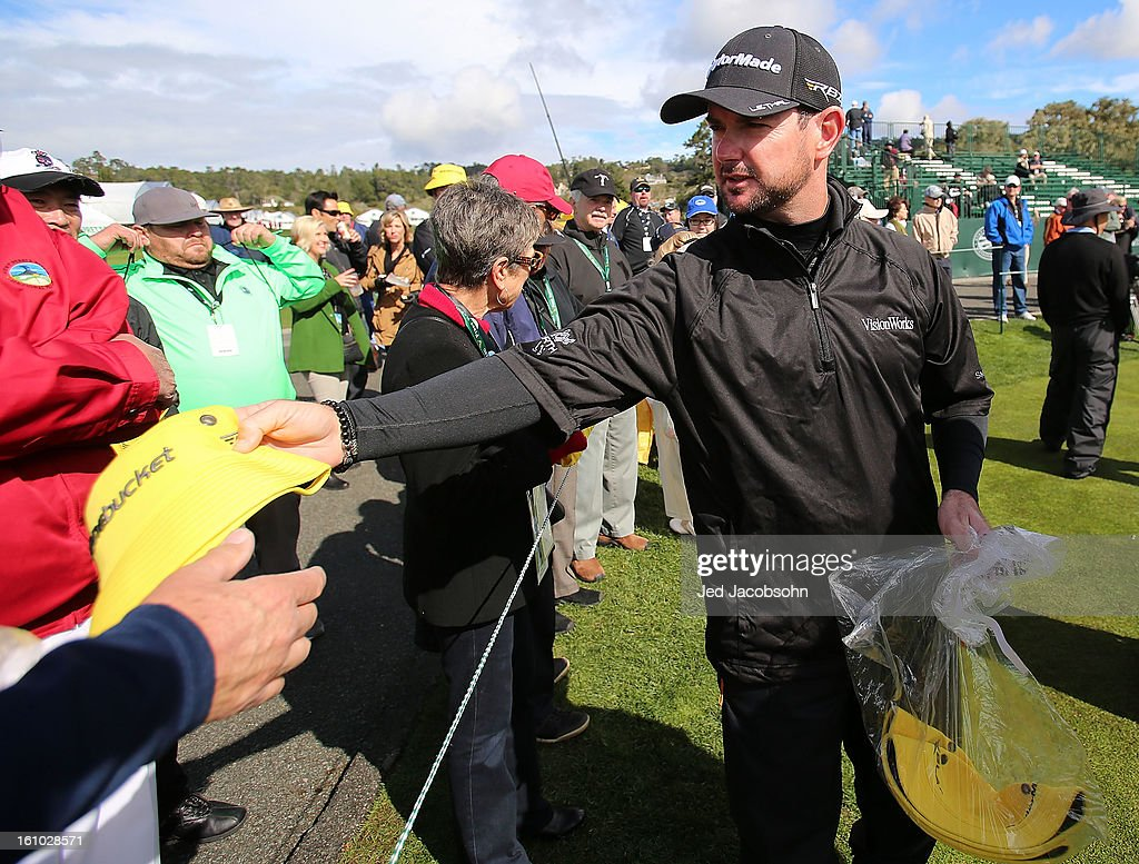 Rory Sabbatini of South Africa gives Taylor Made bucket hats to a fans on the 17th hole during the second round of the AT&T Pebble Beach National Pro-Am at Pebble Beach Golf Links on February 8, 2013 in Pebble Beach, California.