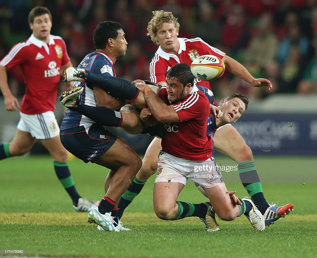 Rory Sidey of the Rebels is tackled by <a gi-track='captionPersonalityLinkClicked' href=/galleries/search?phrase=Brad+Barritt&family=editorial&specificpeople=4542508 ng-click='$event.stopPropagation()'>Brad Barritt</a> during the International Tour Match between the Melbourne Rebels and the British & Irish Lions at AAMI Park on June 25, 2013 in Melbourne, Australia.