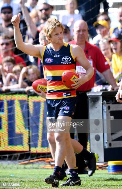 Rory Sloane acknowleges the crowd as he enters the oval during an Adelaide Crows AFL Grand Final training session at Adelaide Oval on September 27...