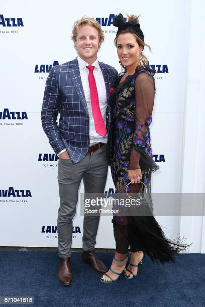 Rory Sloane and Belinda Sloane pose at the Lavazza Marquee on Melbourne Cup Day at Flemington Racecourse on November 7 2017 in Melbourne Australia