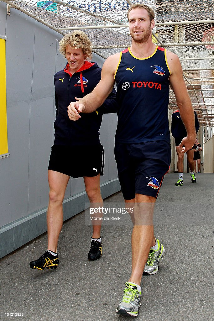 Rory Sloane and <a gi-track='captionPersonalityLinkClicked' href=/galleries/search?phrase=Ben+Rutten&family=editorial&specificpeople=234363 ng-click='$event.stopPropagation()'>Ben Rutten</a> walks out before taking part in an Adelaide Crows AFL training session at AAMI Stadium on March 21, 2013 in Adelaide, Australia.