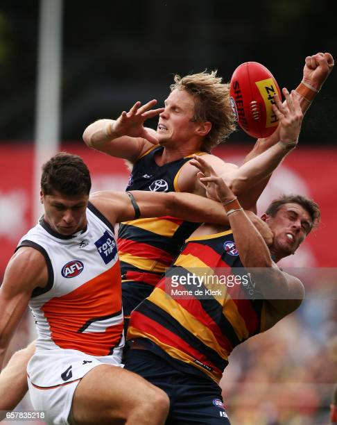 Rory Sloane and Daniel Talia of the Crows compete against Jonathon Patton of the Giants during the round one AFL match between the Adelaide Crows and...