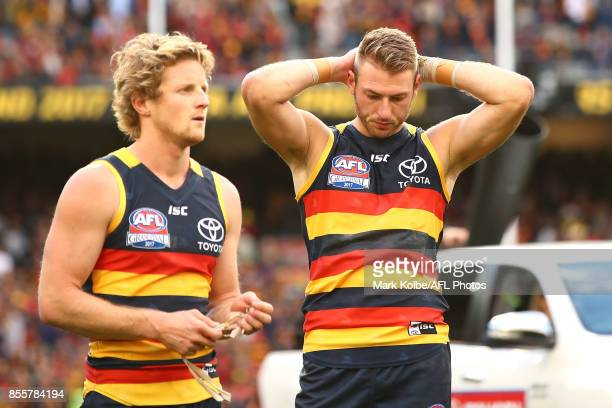 Rory Sloane and Daniel Talia of the Crows look dejected after defeat during the 2017 AFL Grand Final match between the Adelaide Crows and the...
