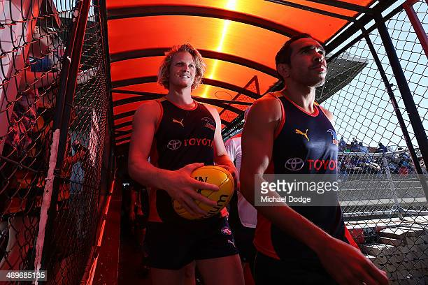 Rory Sloane and Eddie Betts of the Crowd walk out to the ground during the round two AFL NAB Challenge Cup match between the Adelaide Crows and the...