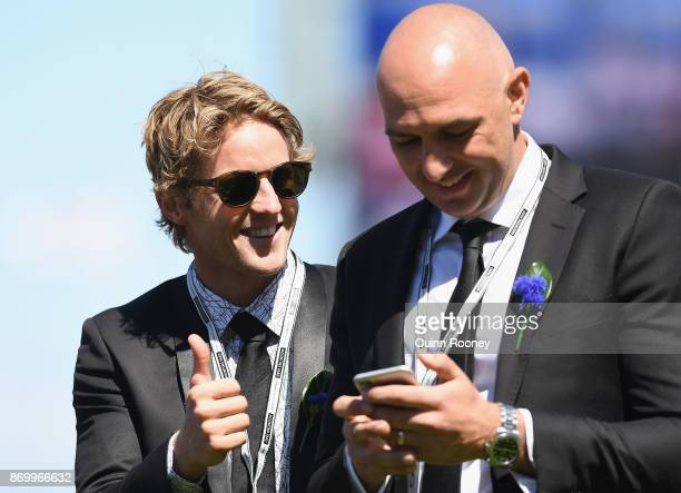 Rory Sloane and James Podsiadly celebrate Merchant Navy winning the Coolmore Stud Stakes on Derby Day at Flemington Racecourse on November 4 2017 in...