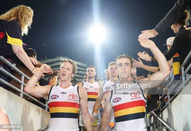 Rory Sloane and Jordan Gallucci of the Crows and their teammates leave the field after winning the round nine AFL match between the Brisbane Lions...