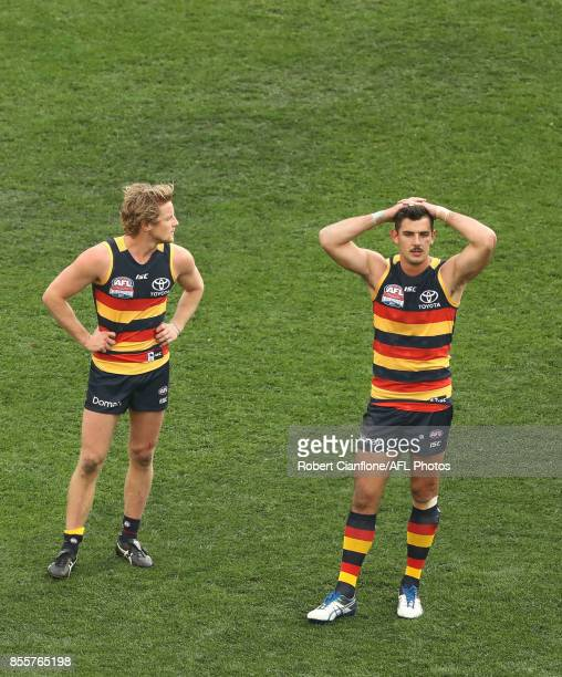 Rory Sloane and Taylor Walker of the Crows are dejected after the Crows were defeayed by the Tigers during the 2017 AFL Grand Final match between the...