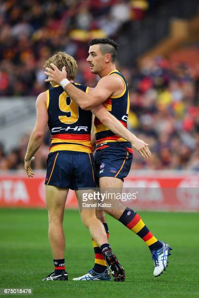 Rory Sloane and Taylor Walker of the Crows embrace during the round six AFL match between the Adelaide Crows and the Richmond Tigers at Adelaide Oval...
