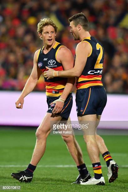 Rory Sloane celebrates with Brad Crouch of the Crows after kicking a goal during the round 18 AFL match between the Adelaide Crows and the Geelong...