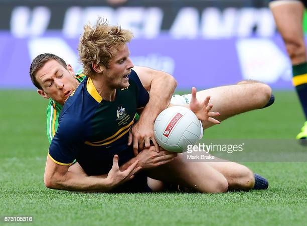 Rory Sloane of Australia tackled by Gary Brennan of Ireland during game one of the International Rules Series between Australia and Ireland at...