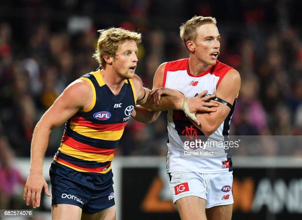Rory Sloane of the Crows and Bernie Vince of the Demons compete during the round eight AFL match between the Adelaide Crows and the Melbourne Demons...