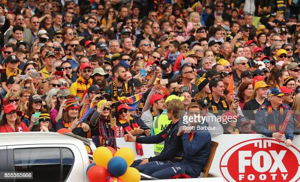 Rory Sloane of the Crows and Richard Douglas of the Crows look on during the 2017 AFL Grand Final Parade on September 29 2017 in Melbourne Australia