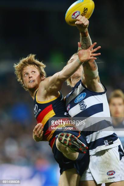 Rory Sloane of the Crows and Tom Stewart of the Cats compete for the ball during the round 11 AFL match between the Geelong Cats and the Adelaide...