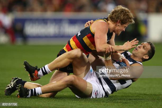 Rory Sloane of the Crows clashes with Harry Taylor of the Cats during the 2017 AFL round 18 match between the Adelaide Crows and the Geelong Cats at...