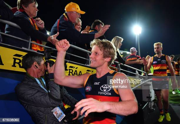 Rory Sloane of the Crows clebrates with fans after the round six AFL match between the Adelaide Crows and the Richmond Tigers at Adelaide Oval on...