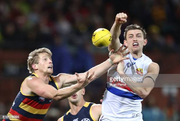 Rory Sloane of the Crows competes for the ball against Fletcher Roberts of the Bulldogs during the round 16 AFL match between the Adelaide Crows and...