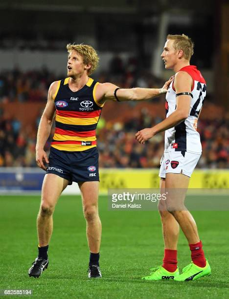 Rory Sloane of the Crows competes with Bernie Vince of the Demons during the round eight AFL match between the Adelaide Crows and the Melbourne...