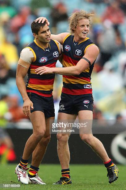 Rory Sloane of the Crows congratulates teammate Jared Petrenko after he kicked a goal during the round ten AFL match between the Adelaide Crows and...