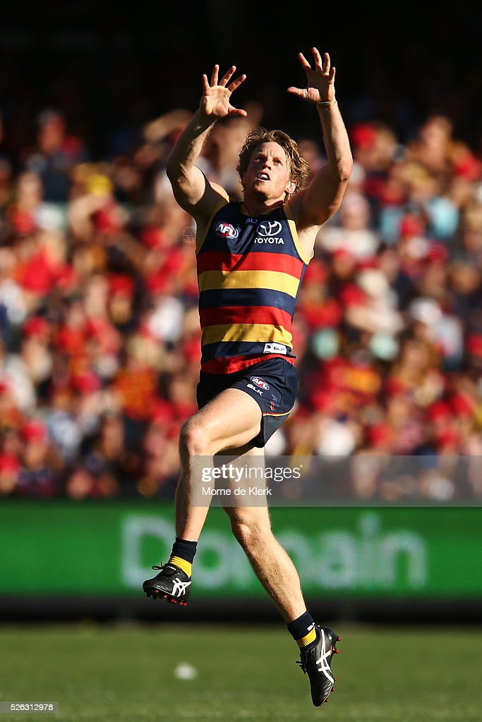 Rory Sloane of the Crows goes up for a mark during the round six AFL match between the Adelaide Crows and the Fremantle Dockers at Adelaide Oval on April 30, 2016 in Adelaide, Australia.