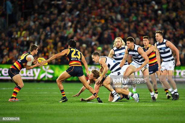 Rory Sloane of the Crows handballs during the round 18 AFL match between the Adelaide Crows and the Geelong Cats at Adelaide Oval on July 21 2017 in...