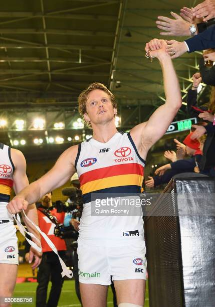 Rory Sloane of the Crows high fives fans after winning the round 21 AFL match between the Essendon Bombers and the Adelaide Crows at Etihad Stadium...