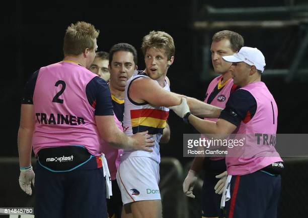 Rory Sloane of the Crows is checked by medical staff after a heavy collision during the round 17 AFL match between the Melbourne Demons and the...