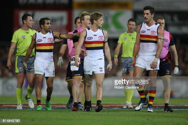 Rory Sloane of the Crows is encouraged to leave the field by teammates after a heavy collision during the round 17 AFL match between the Melbourne...