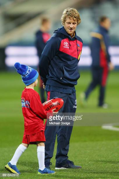 Rory Sloane of the Crows is greeted by a fan during the round 11 AFL match between the Geelong Cats and the Adelaide Crows at Simonds Stadium on June...