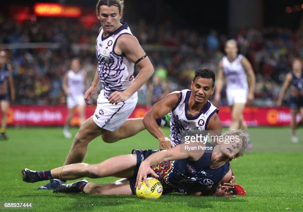 Rory Sloane of the Crows is tackled by Danyle Pearce of the Dockers during the round 10 AFL match between the Adelaide Crows and the Fremantle...