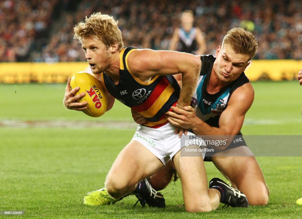 Rory Sloane of the Crows is tackled by Ollie Wines of the Power during the round three AFL match between the Port Adelaide Power and the Adelaide Crows at Adelaide Oval on April 8, 2017 in Adelaide, Australia.