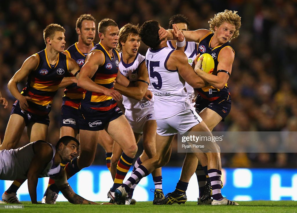 Rory Sloane of the Crows is tackled by Ryan Crowley of the Dockers during the AFL Second Semi Final match between the Adelaide Crows and the Fremantle Dockers at AAMI Stadium on September 14, 2012 in Adelaide, Australia.