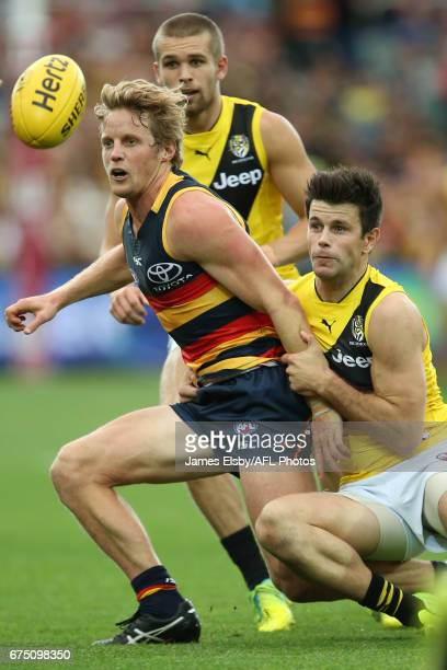 Rory Sloane of the Crows is tackled by Trent Cotchin of the Tigers during the 2017 AFL round 06 match between the Adelaide Crows and the Richmond...