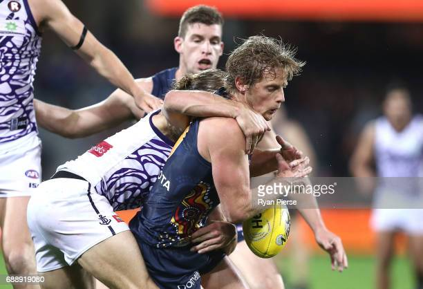 Rory Sloane of the Crows is tackled high during the round 10 AFL match between the Adelaide Crows and the Fremantle Dockers at Adelaide Oval on May...