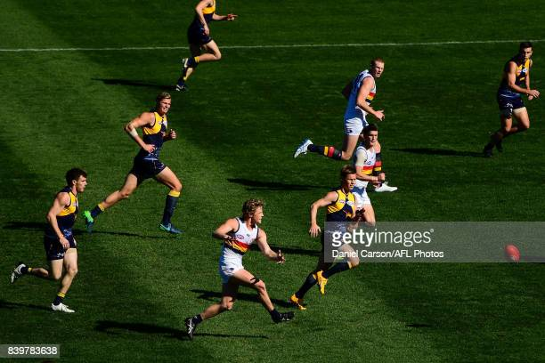 Rory Sloane of the Crows kicks the ball during the 2017 AFL round 23 match between the West Coast Eagles and the Adelaide Crows at Domain Stadium on...