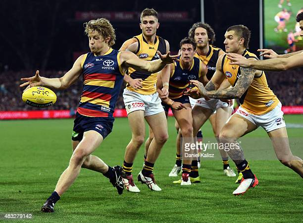 Rory Sloane of the Crows kicks the ball during the round 19 AFL match between the Adelaide Crows and Richmond Tigers at Adelaide Oval on August 7...
