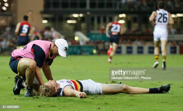 Rory Sloane of the Crows lays injured during the 2017 AFL round 17 match between the Melbourne Demons and the Adelaide Crows at TIO Stadium on July...