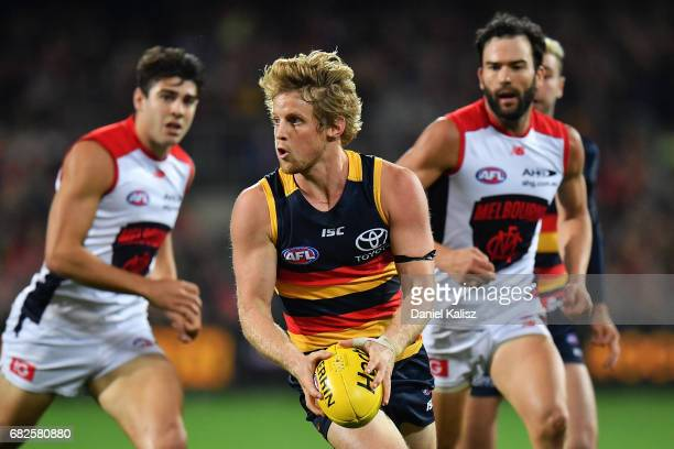 Rory Sloane of the Crows looks to pass the ball during the round eight AFL match between the Adelaide Crows and the Melbourne Demons at Adelaide Oval...