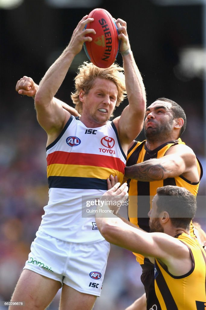 Rory Sloane of the Crows marks infront of Shaun Burgoyne of the Hawks during the round two AFL match between the Hawthorn Hawks and the Adelaide Crows at Melbourne Cricket Ground on April 1, 2017 in Melbourne, Australia.