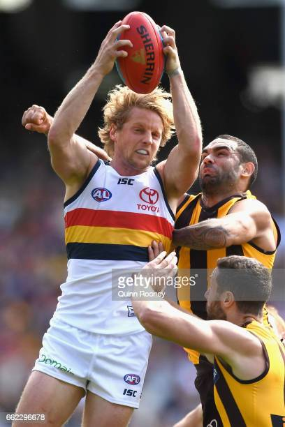 Rory Sloane of the Crows marks infront of Shaun Burgoyne of the Hawks during the round two AFL match between the Hawthorn Hawks and the Adelaide...