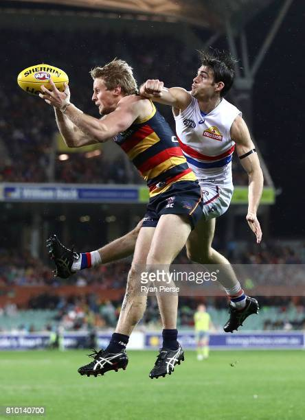 Rory Sloane of the Crows marks over Easton Wood of the Bulldogs during the round 16 AFL match between the Adelaide Crows and the Western Bulldogs at...