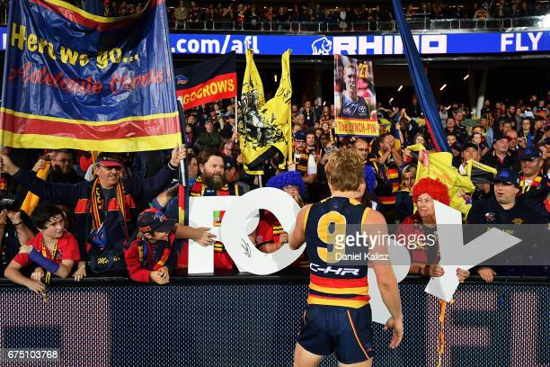 Rory Sloane of the Crows reacts to fans after the round six AFL match between the Adelaide Crows and the Richmond Tigers at Adelaide Oval on April 30...