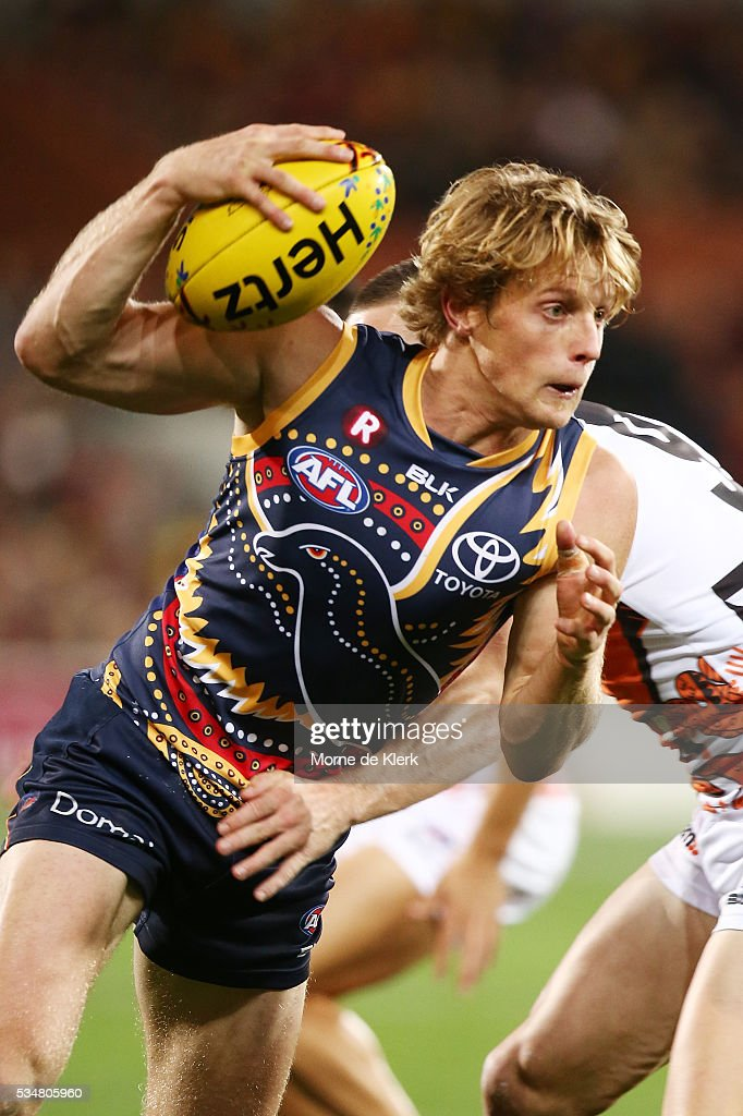 Rory Sloane of the Crows runs with the ball during the round 10 AFL match between the Adelaide Crows and the Greater Western Sydney Giants at Adelaide Oval on May 28, 2016 in Adelaide, Australia.