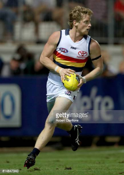 Rory Sloane of the Crows runs with the ball during the round 17 AFL match between the Melbourne Demons and the Adelaide Crows at TIO Stadium on July...