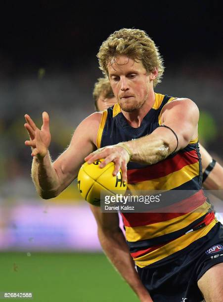 Rory Sloane of the Crows runs with the ball during the round 20 AFL match between the Adelaide Crows and the Port Adelaide Power at Adelaide Oval on...