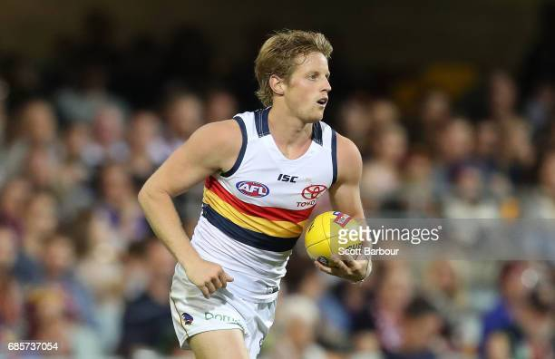 Rory Sloane of the Crows runs with the ball during the round nine AFL match between the Brisbane Lions and the Adelaide Crows at The Gabba on May 20...