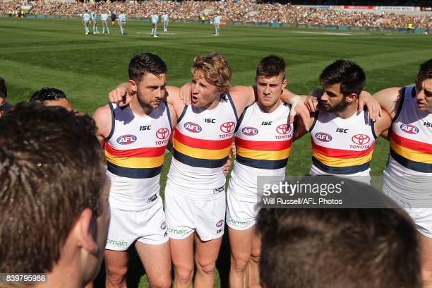 Rory Sloane of the Crows speaks to the huddle at the start of the game during the round 23 AFL match between the West Coast Eagles and the Adelaide...