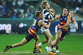 Rory Sloane of the Crows tackles Cameron Guthrie of the Cats during the round 18 AFL match between the Geelong Cats and the Adelaide Crows at Simonds...
