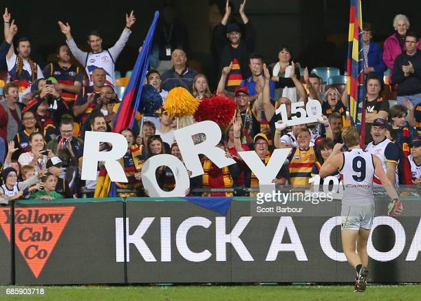 Rory Sloane of the Crows thanks his supporters in the crowd after playing his 150th game and winning the round nine AFL match between the Brisbane...