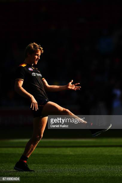 Rory Sloane of the Crows warms up prior to the round six AFL match between the Adelaide Crows and the Richmond Tigers at Adelaide Oval on April 30...