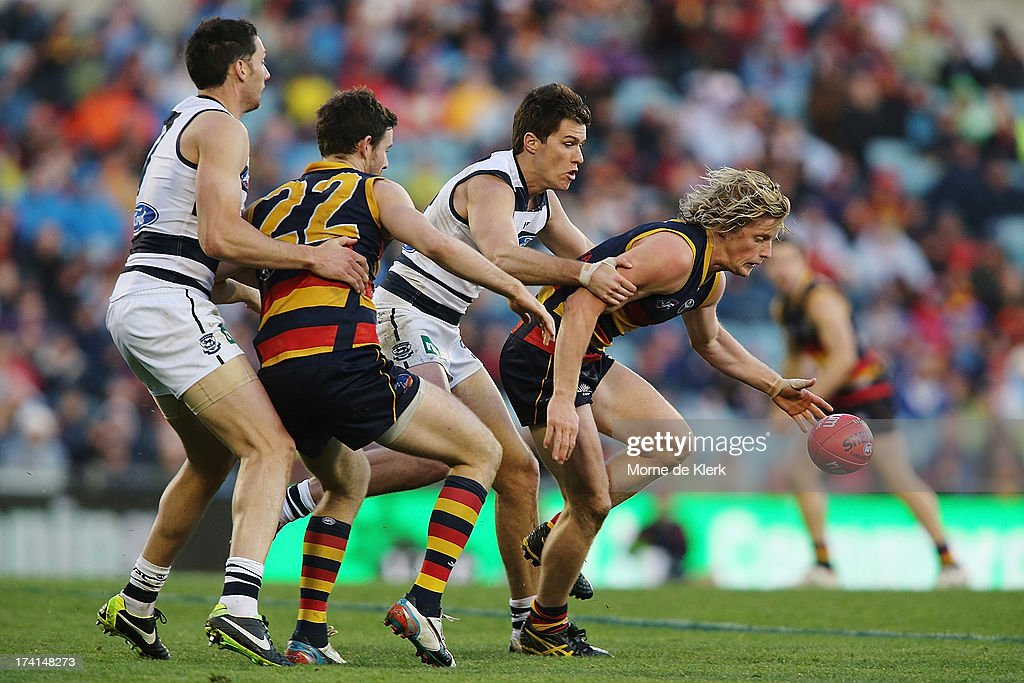 Rory Sloane (R) of the Crows wins the ball during the round 17 AFL match between the Adelaide Crows and the Geelong Cats at AAMI Stadium on July 21, 2013 in Adelaide, Australia.